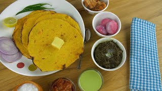 Closeup shot - Punjabi Thali with Makii Ki roti and butter revolving on a turntable