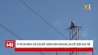 Giải cứu đối tượng nghi ngáo đá leo cột điện cao thế trên đường Kinh Dương Vương | Tin nóng 24H