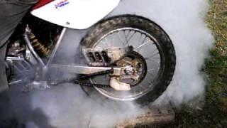 Dirt bike burnout until tire pops