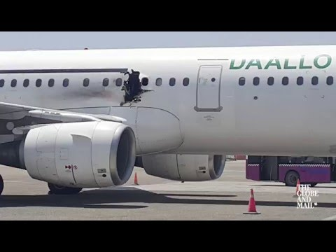 Footage captures scene inside Daallo Airlines flight after explosion rips a hole in it