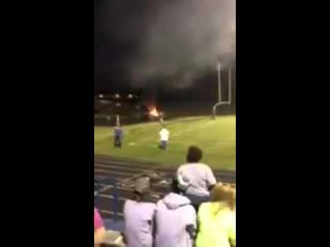 Motorcycle catches on fire at Homecoming game at Alexander Central High School.