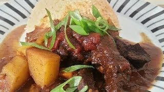 Jamaican  Brown Stew Beef  With Tomato  Rice