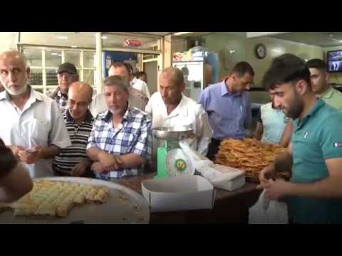 Mosul's favorite sweet shop back in business