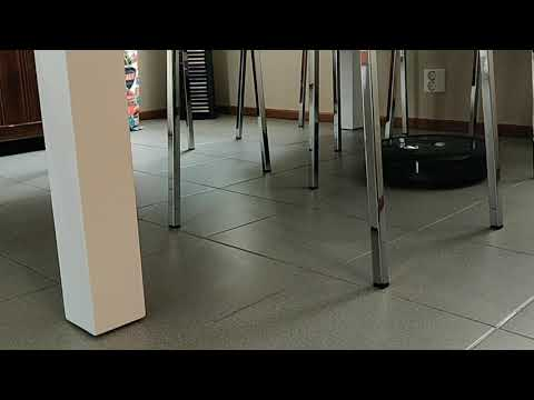 Roomba i7+ cleaning under a kitchen table