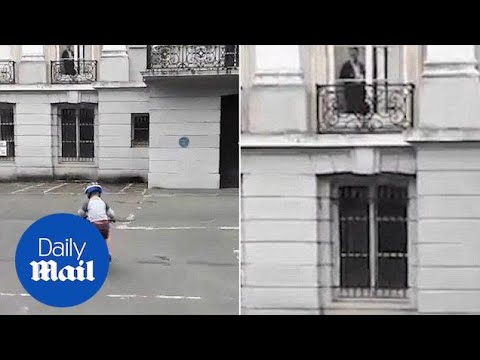 Bizarre footage shows 'ghost' woman watches over boy riding bike - Daily Mail