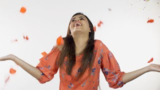 Pretty lady dancing while listening to loud music at a party against the white background