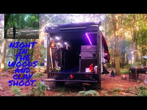 Land rover 4x4 camper van night in the woods and clay shoot.