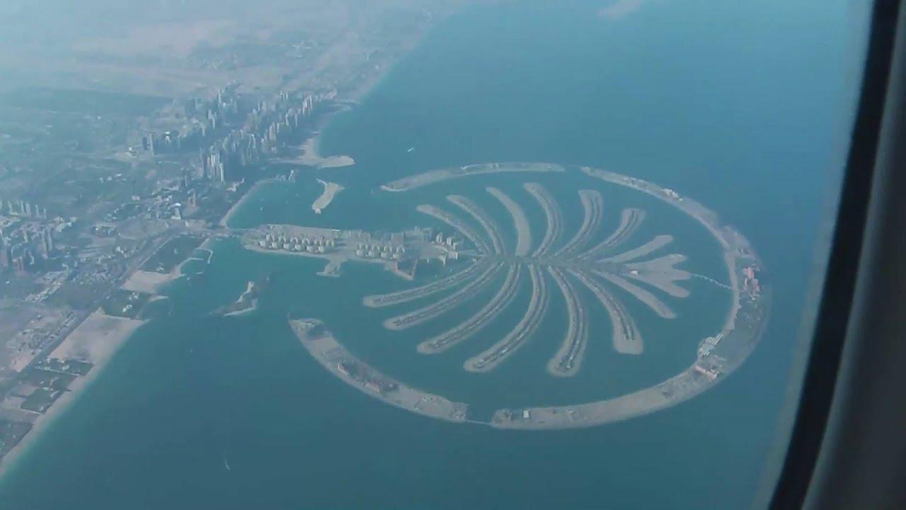 Emirates 777 flying over Palm Island Dubai - YouTube