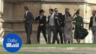 Cara Delevingne wears a suit at pal Eugenie's royal wedding