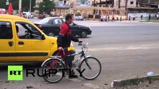 Ukraine: Dead bodies lay on Lugansk street after fresh shelling *GRAPHIC*