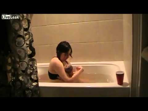 Woman Giving Birth in a Bathtub - YouTube