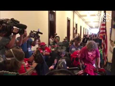 Disabled Protestors Rally Outside Mitch McConnell