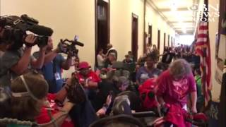 Disabled Protestors Rally Outside Mitch McConnell's Office over Medicaid Cuts