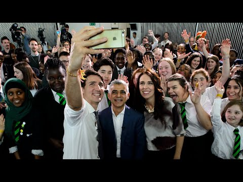 Jacinda Ardern and Justin Trudeau talk to young Londoners