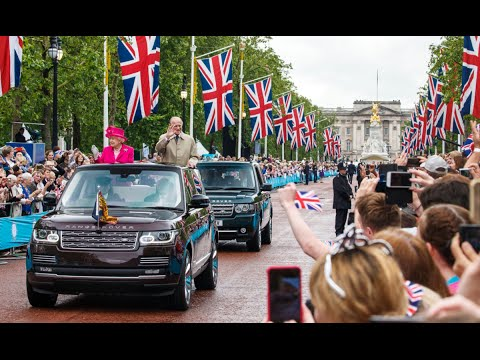 The Queen and The Duke of Edinburgh Travel Down The Mall in the State Review Range Rover