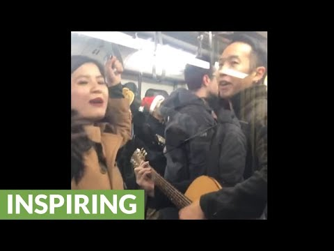 Skytrain Transit Commuters Burst In Christmas Caroling