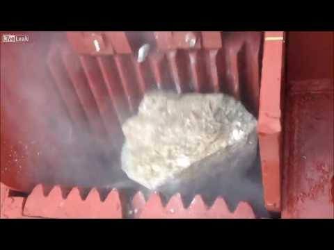 Homemade gravel:  Industrial rock crusher's turning stone into gravel