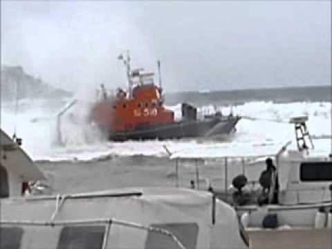 Greek coastguard lifeboats in heavy storm in the harbor