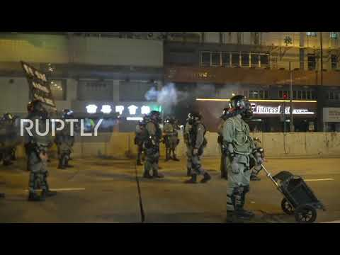 Hong Kong: Police fire tear gas on protesters as demonstrations go ahead