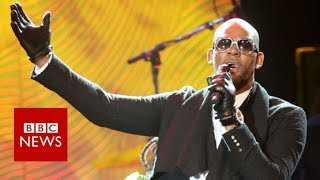 R Kelly denies allegations of holding young women against their will - BBC News