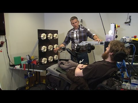 Touched by Science: Paralyzed Man Feels Again Through Mind-Controlled Robotic Arm