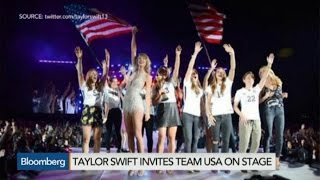 Taylor Swift Invites Team USA on Stage, Kisses Trophy