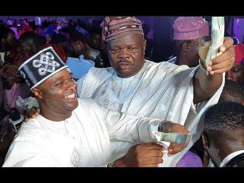 See how Femi Adebayo, MC Oluomo spray bundle of cash on Abimbola and Okiki at Their Wedding
