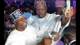 See how Femi Adebayo MC Oluomo spray bundle of cash on Abimbola and Okiki at Their Wedding