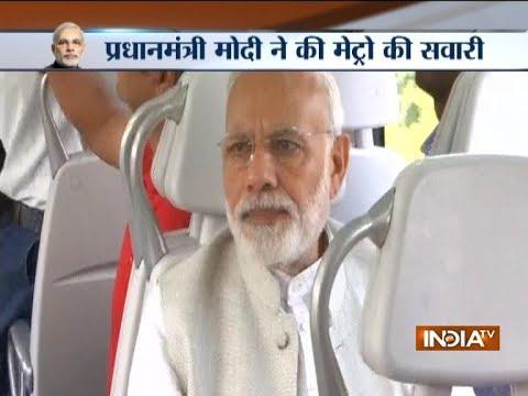 PM Narendra Modi rides in a metro from Dhaula Kuan to Dwarka