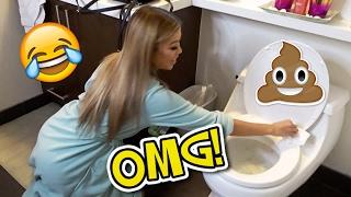 STUCK HER HAND IN THE TOILET!