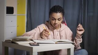 Teenager Studying With Music Stock Video