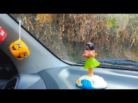 Dancing Girl On Car Dashboard