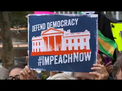 Protesters March Through Manhattan Demanding Impeachment Of President Trump