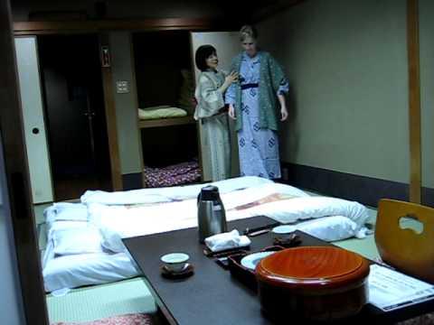 Ryokan maid taking over our room - Kyoto, Japan
