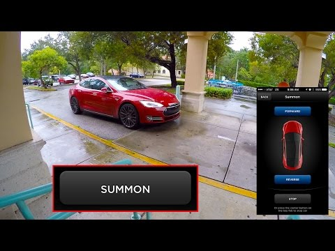 Tesla Model S Picks Owner up in the Rain using the new Summon Feature