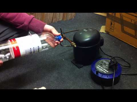 Fitting bottle top on old ice cream freezer compressor to then blow up a plastic bottle !