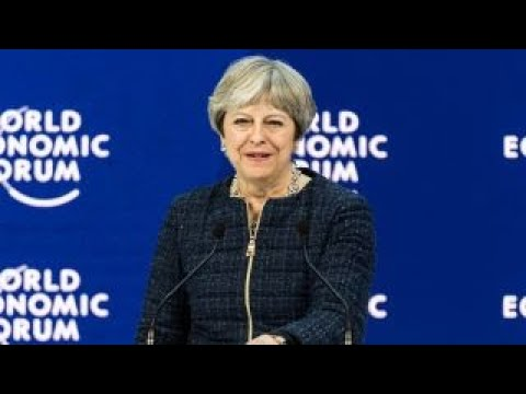 British PM May warns tech firms