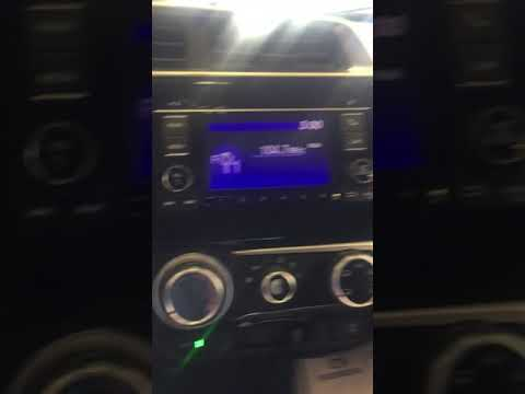 Programming a radio station on an LX Honda vehicle