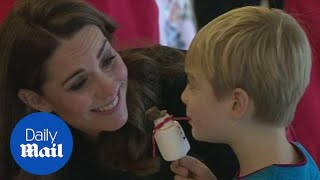 Kate tells a little boy that Prince George loves planes too