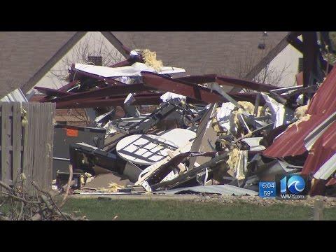 National Weather Service meteorologists assess tornado damage