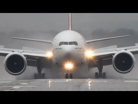 Wet runway! Emirates Boeing 777-300 blowing up the water.