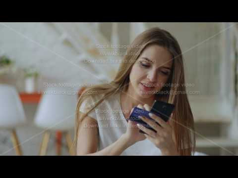 Beautiful young woman have online banking and shopping using smartphone and credit card at home