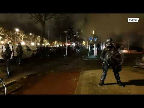Netherlands: Riot police patrol streets following anti-curfew demo in Rotterdam