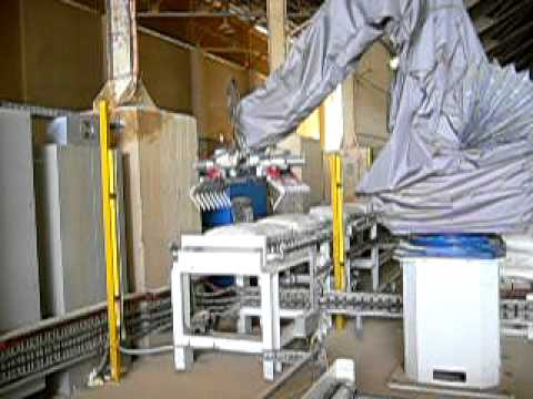 Fuji-Ace Robot Palletiser Stacks Phosphate Bags For Sea Freight.