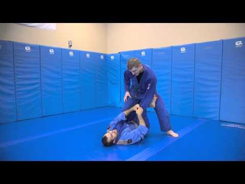 One legged X-guard to reverse X-guard sweep