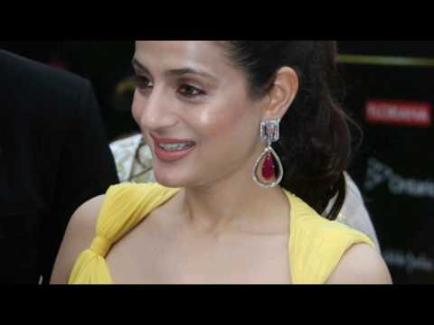 Amisha Patel Transparent Yellow Dress on Award Screen thumbnail