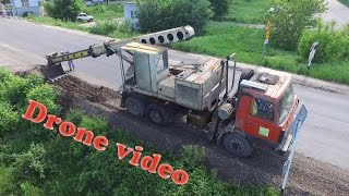 [Drone video] Tatra 815 UDS-114 digging roadside(, 2016-06-21T04:14:42.000Z)