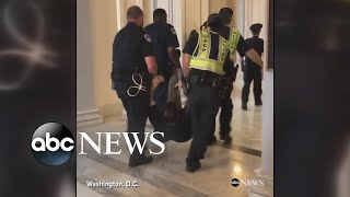 Protesters dragged away from Sen. McConnell's office