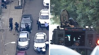 Police hail 'miracle' rescue of trapped officers as 6 injured in 7-hour hostage standoff