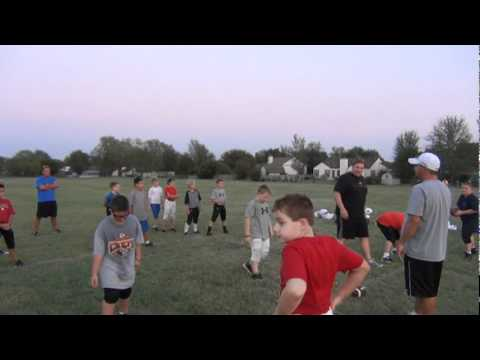 brandon-knowles-snapping-for-goddard-junior-lions-4th-grade-football